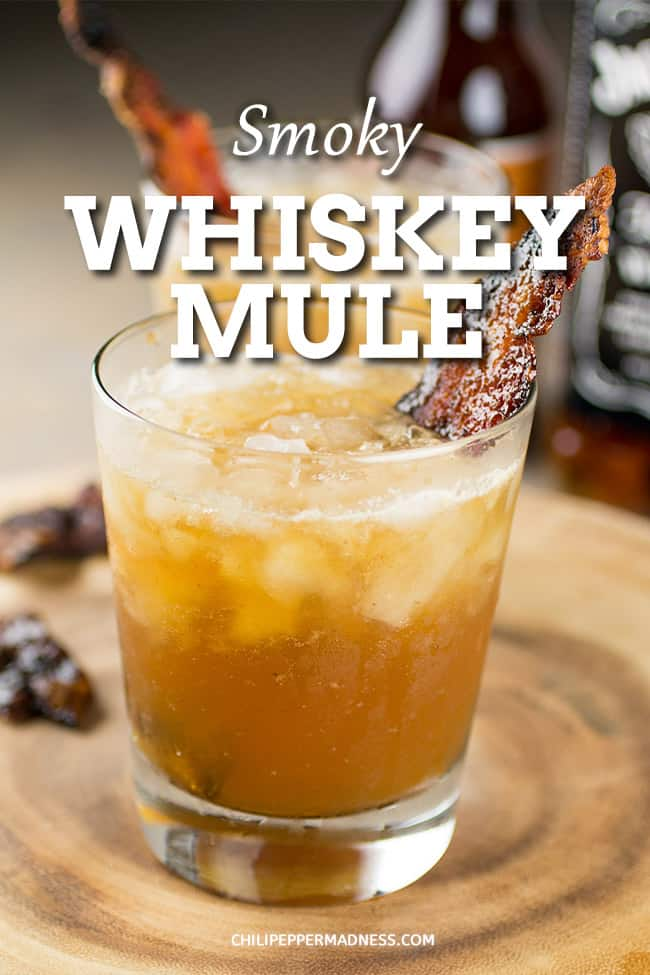 Smoky Whiskey Mule Cocktail - A refreshing and summery whiskey mule cocktail recipe made with ginger beer, whiskey, lemon juice and candied bacon. Whiskey lovers rejoice! #whiskey #moscowmule #cocktail