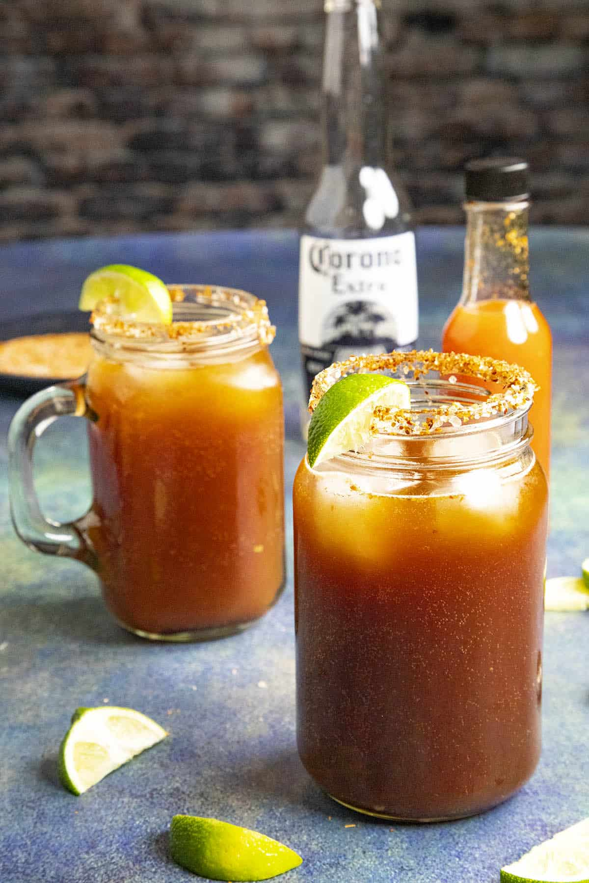 Two micheladas, Mexican beer and Clamato juice cocktails
