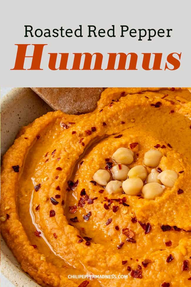 Roasted Red Pepper Hummus - This homemade roasted red pepper hummus recipe is smooth and creamy and so much better when made from scratch. Great for game day, holidays or an anytime snack. Don\'t forget the pitas! #appetizer #hummus #chickpeas #roastedredpeppers
