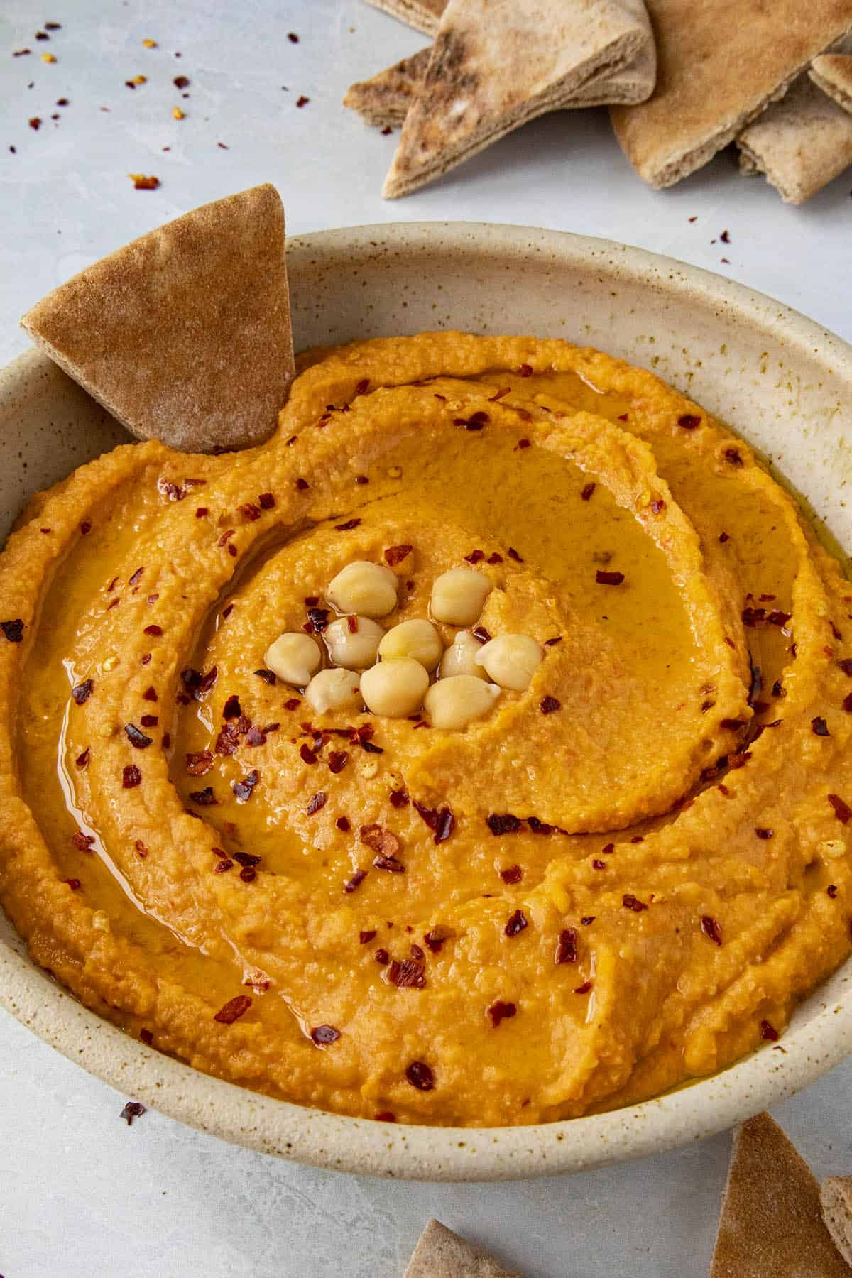 Creamy Roasted Red Pepper Hummus in a bowl, ready to serve