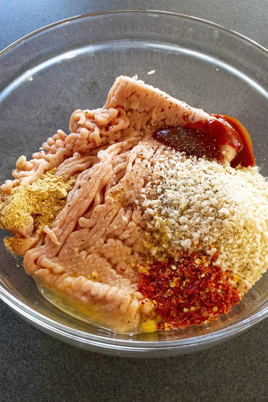 Seasoned chicken mixture ready to make chicken meatballs