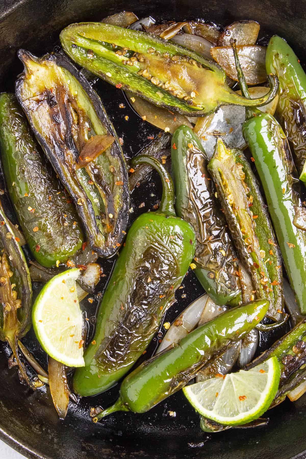 Chiles Toreados, or blistered chiles, in a pan