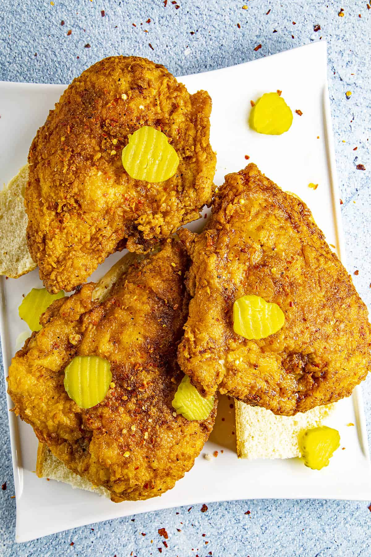 Three pieces of Nashville Hot Chicken on a plate, ready to serve