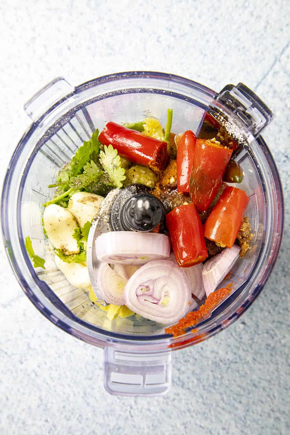 The ingredients in a blender to make Thai red curry paste