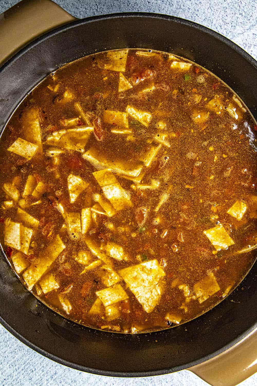 Adding fresh corn tortillas to thicken the chicken tortilla soup