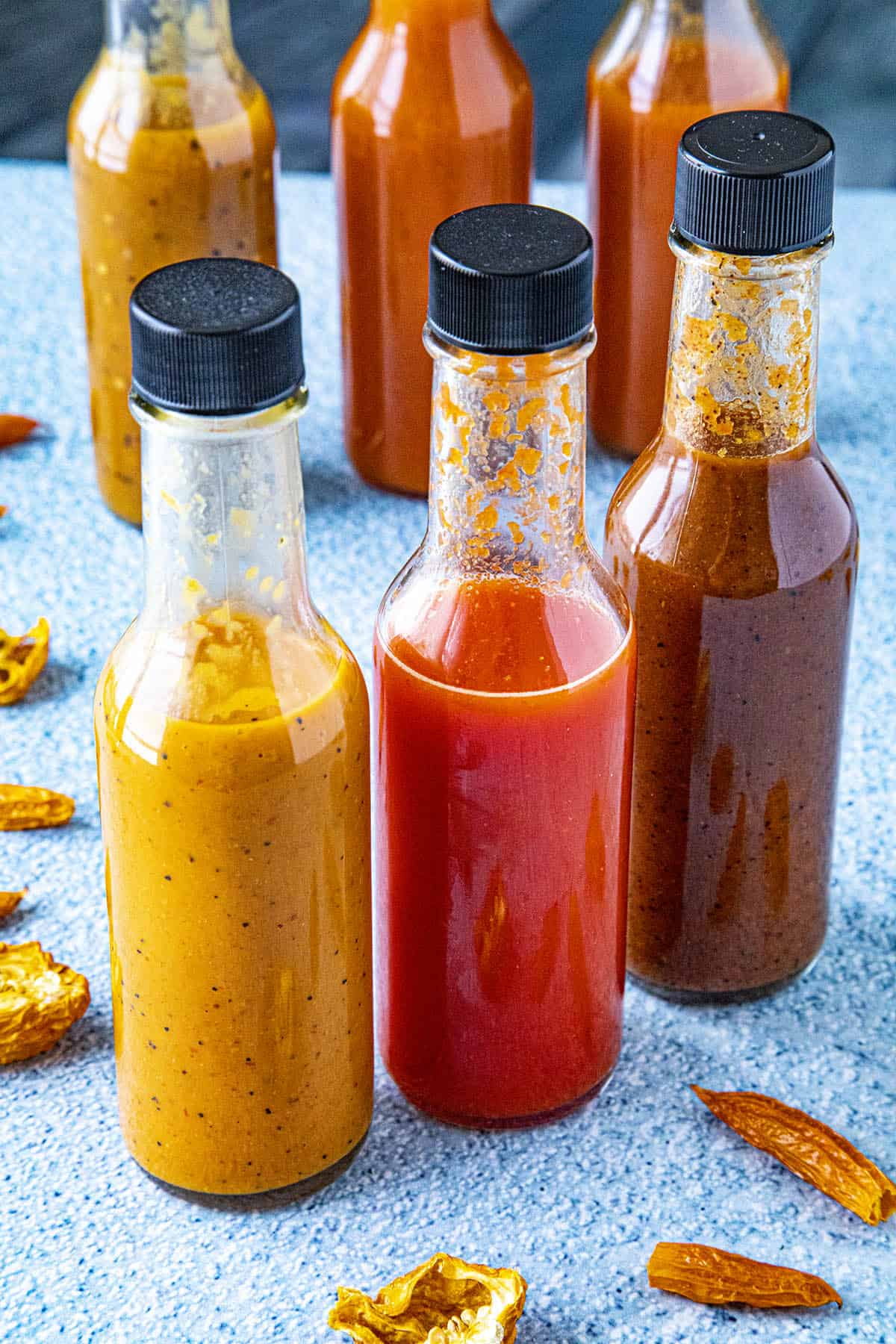 3 bottles of hot sauce, each made from dried chili peppers