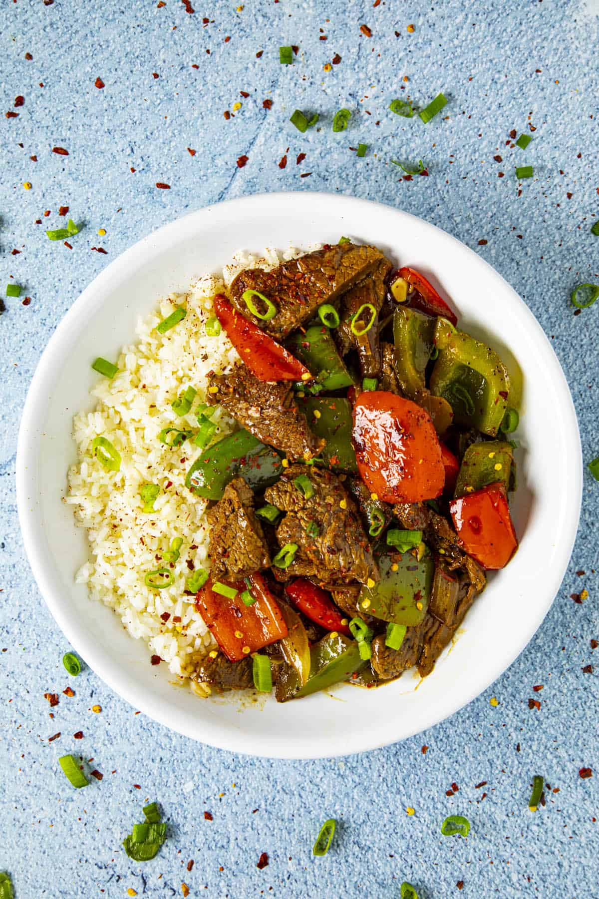 Pepper Steak in a bowl over rice, ready to serve