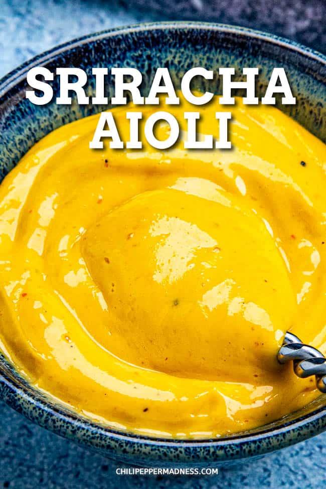 Creamy Sriracha Aioli - This creamy sriracha aioli recipe is easy to make and real, made with egg yolk, oil and sriracha, not mayo. Make with a whisk, food processor or blender. #sriracha #aioli #creamy
