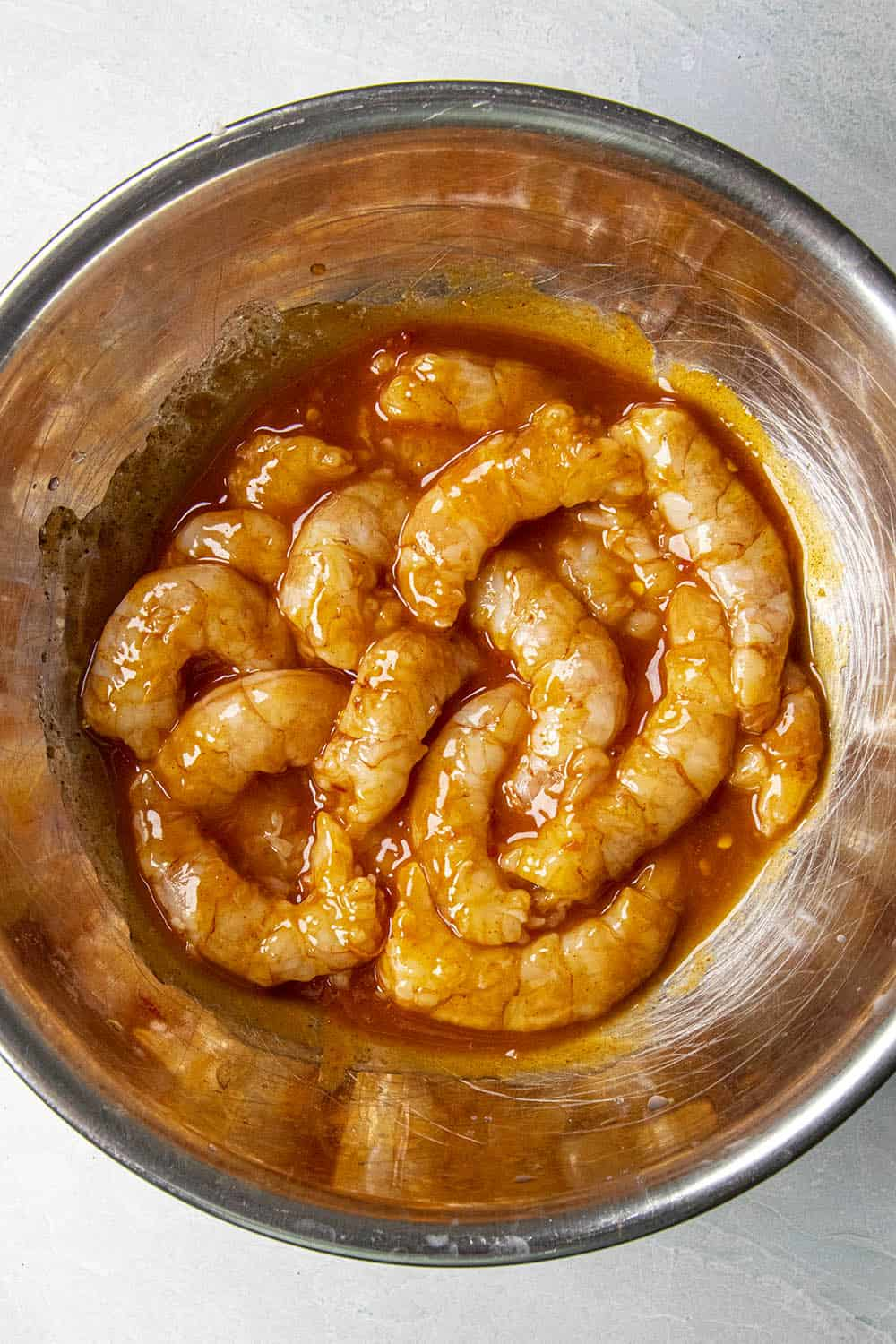 Marinating the shrimp in a bowl