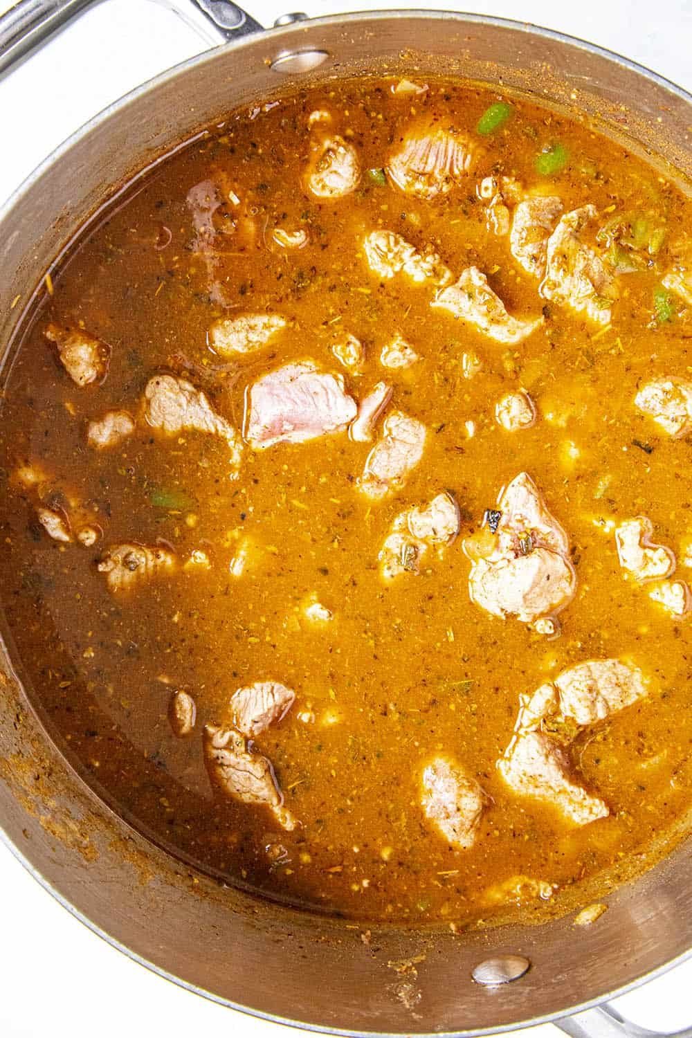Carne Adovada simmering in a pot