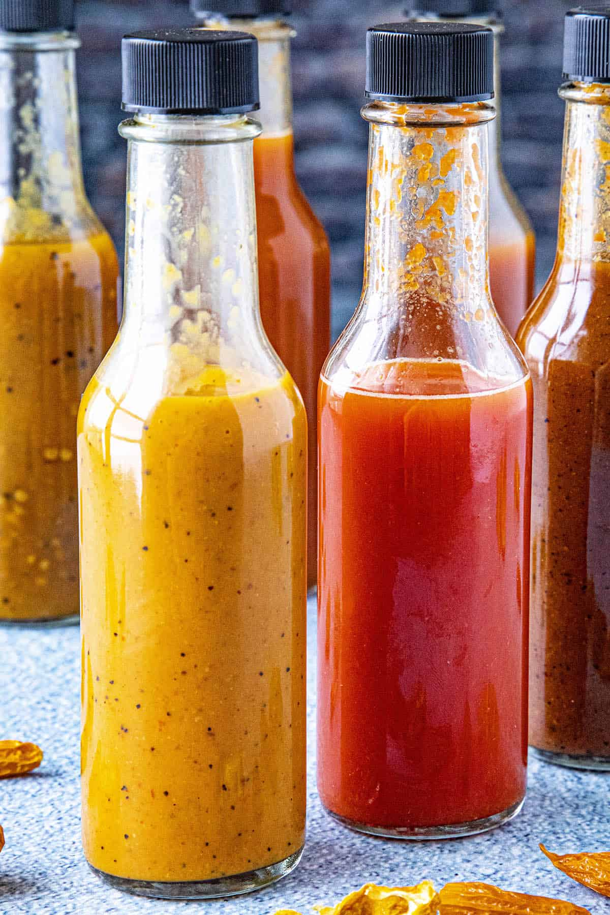 Several bottles of hot sauce made from chili powders