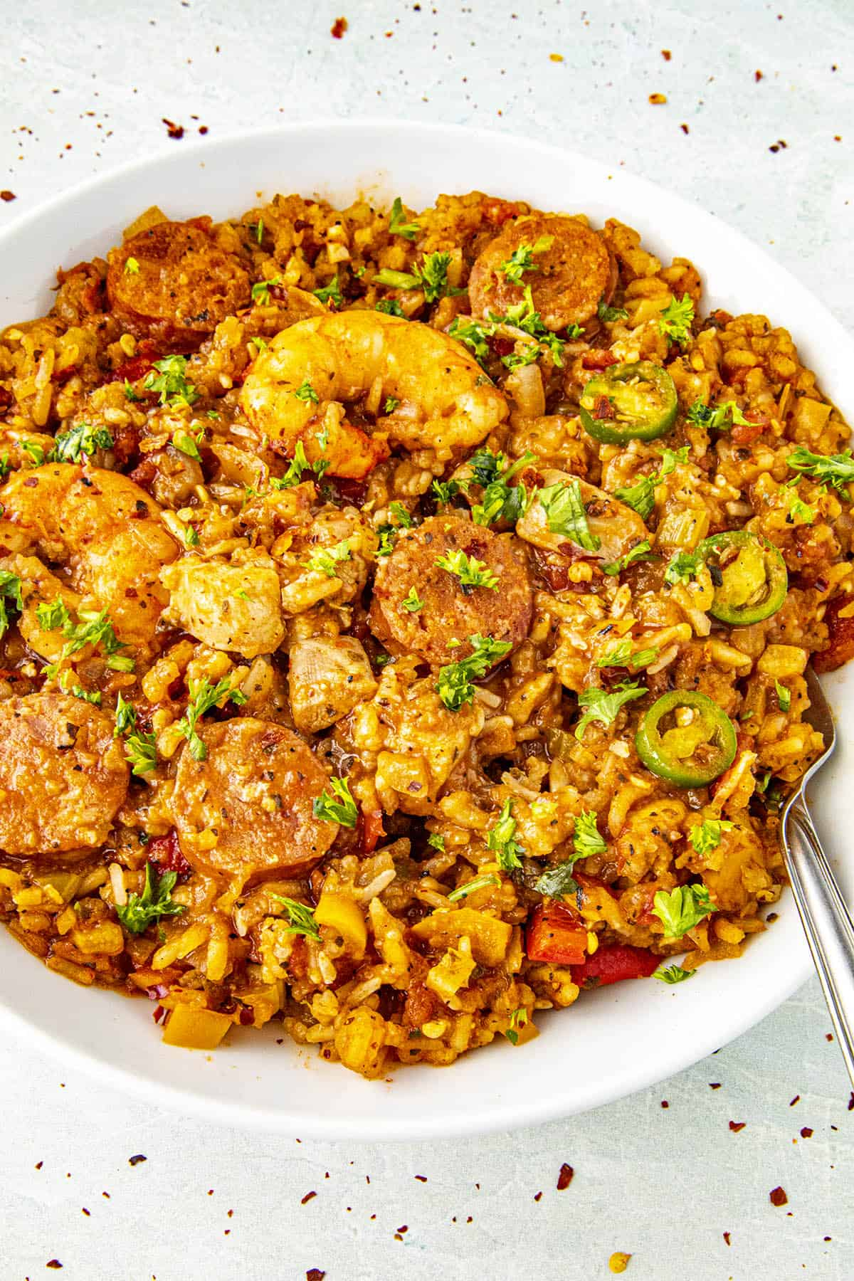 Delicious jambalaya in a bowl with a fork