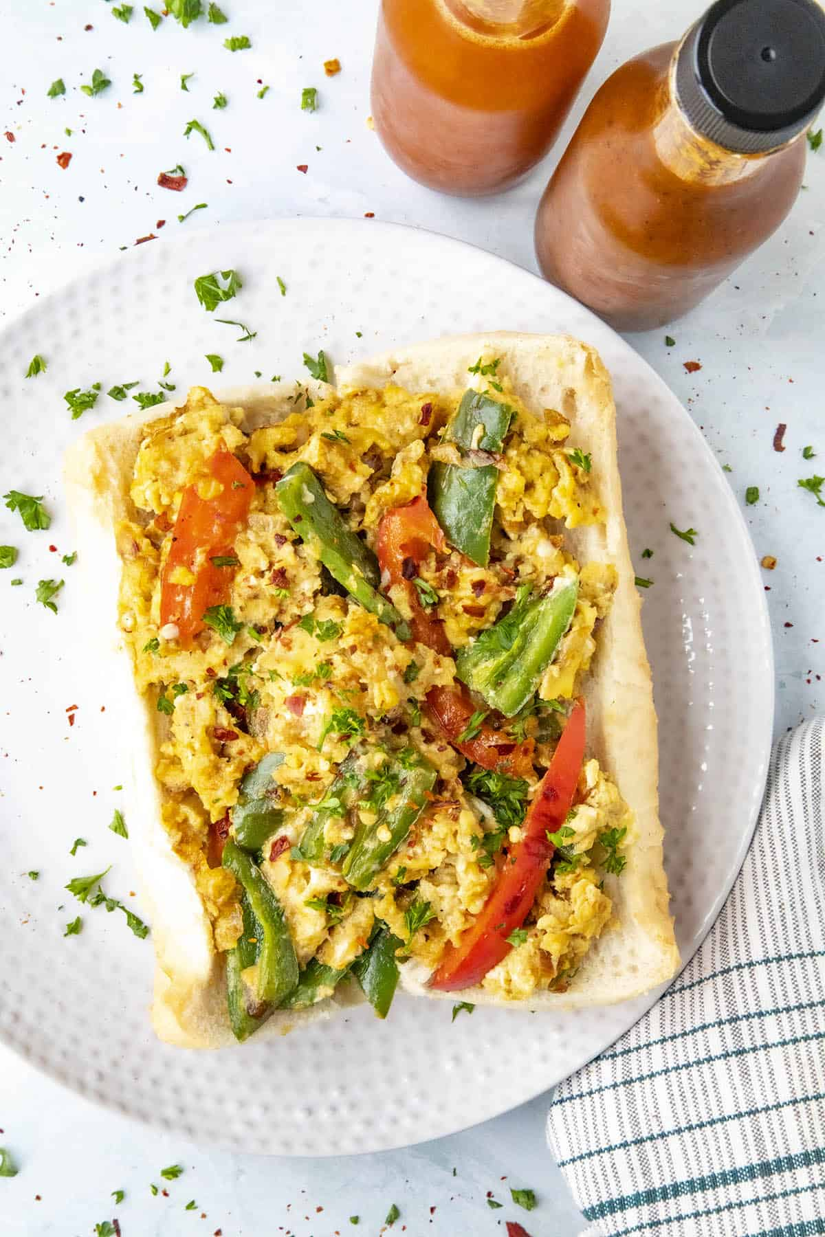 Pepper and Egg Sandwich with lots of peppers and hot sauce