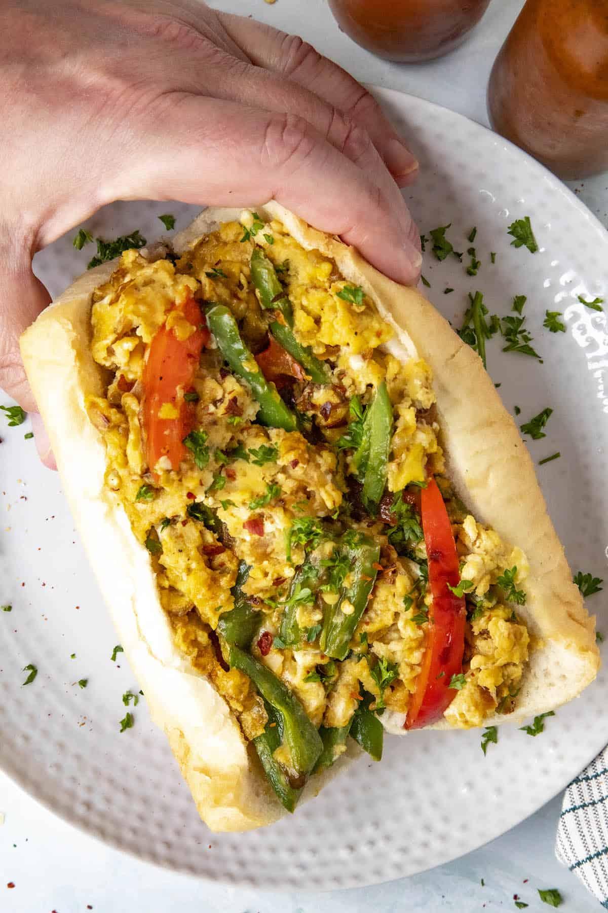 Grabbing my Pepper and Egg Sandwich