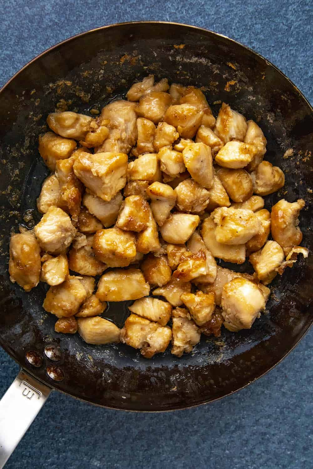 Cooking the seasoned chicken in a hot pan