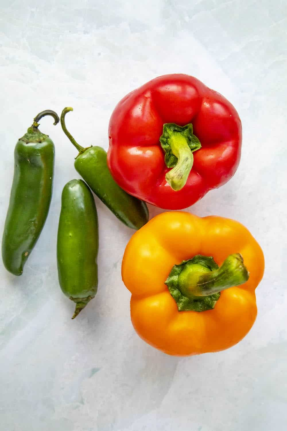 Bell peppers and jalapeno peppers for making sausage and peppers for dinner