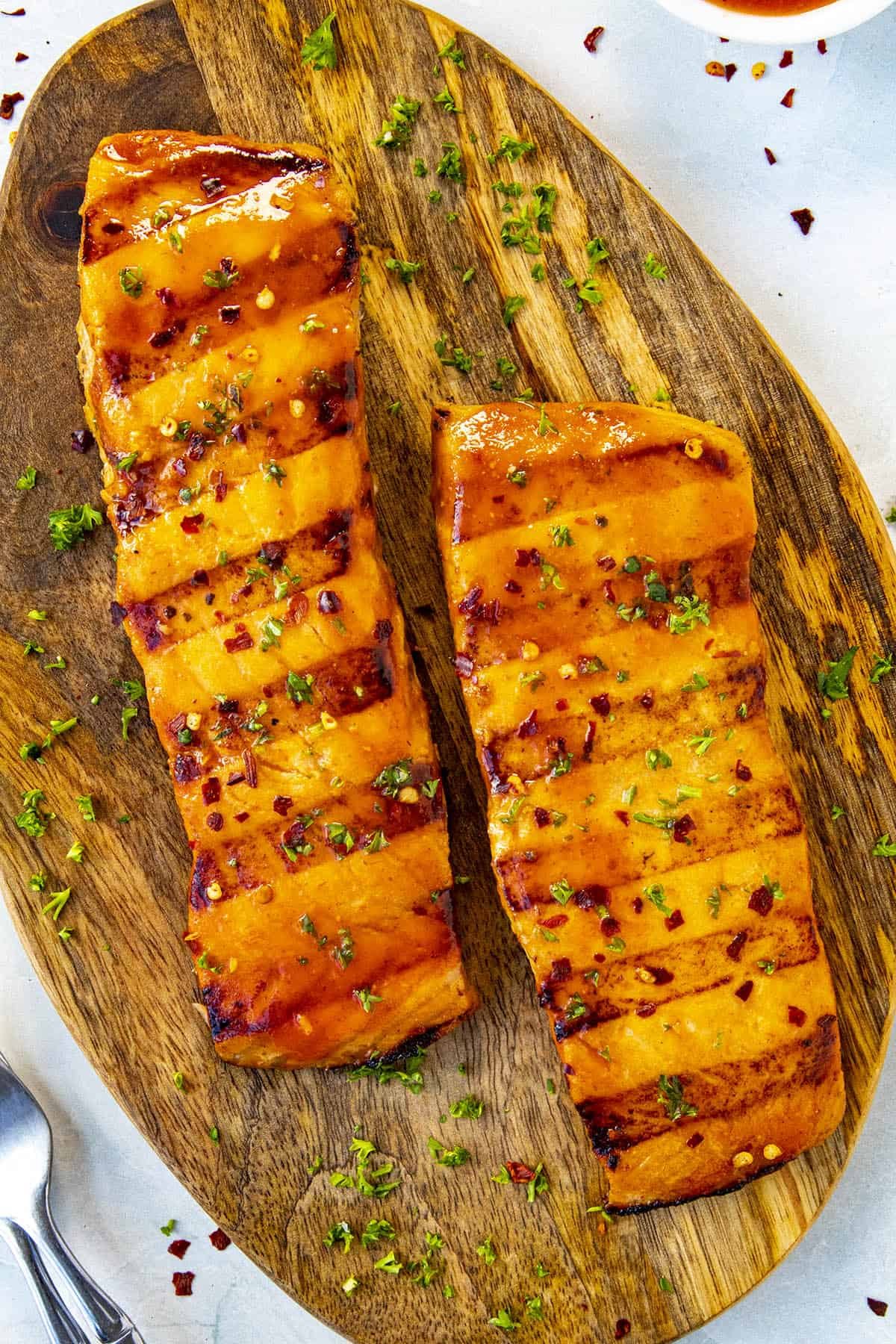 Perfectly seared grilled salmon fillets with honey sriracha sauce