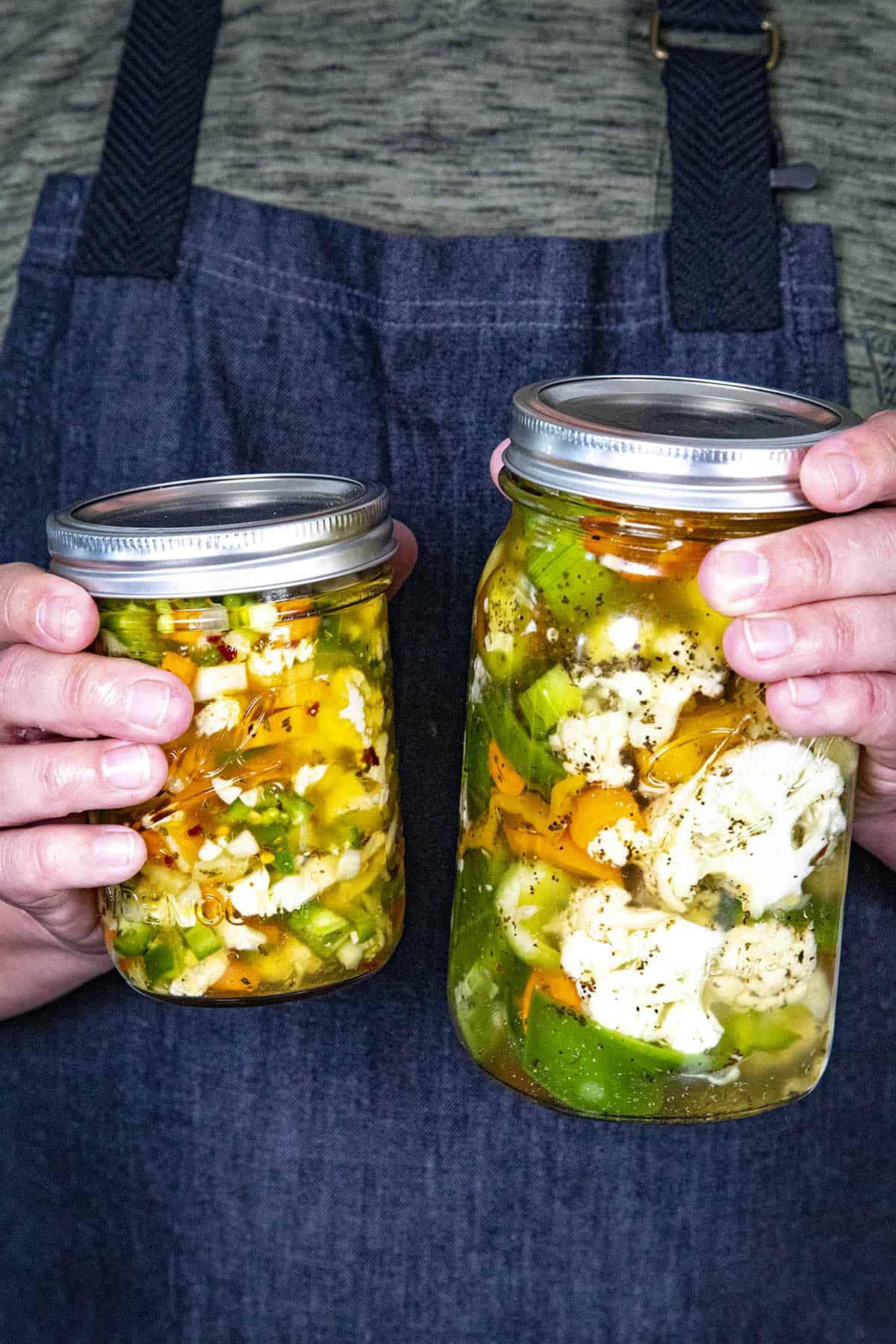Mike holding 2 jars of Italian Giardiniera