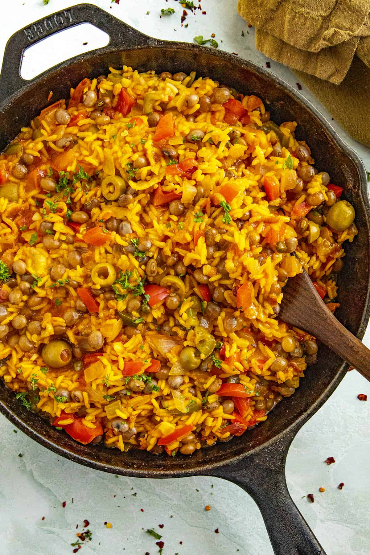 Scooping Arroz con Gandules from a pan