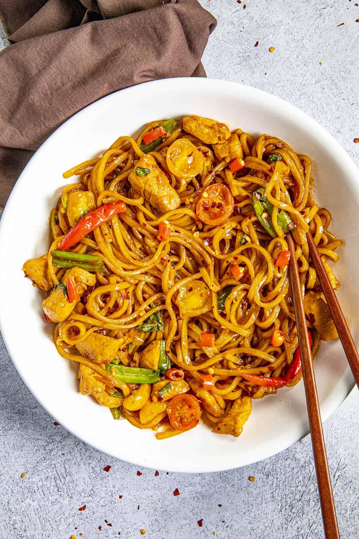 Drunken Noodles in a bowl with chopsticks