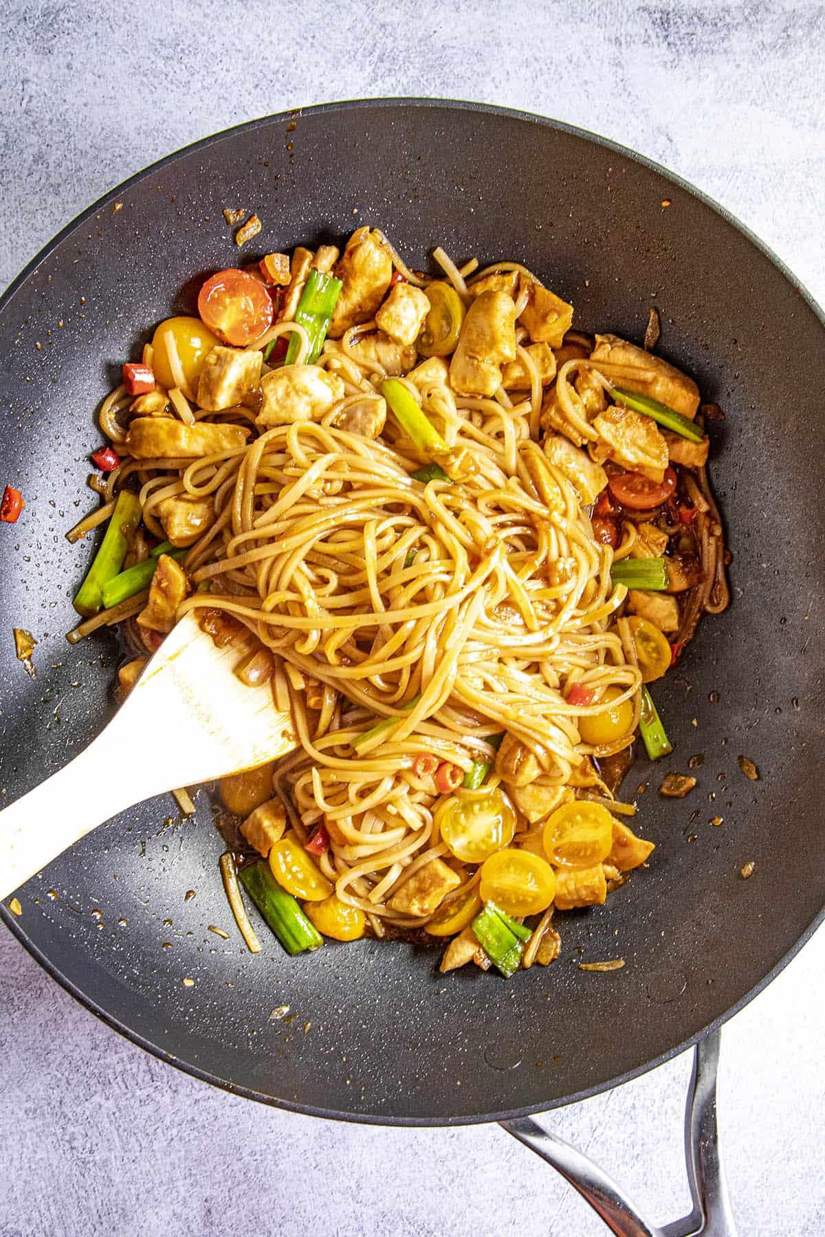 Stirring Drunken Noodles into the hot pan