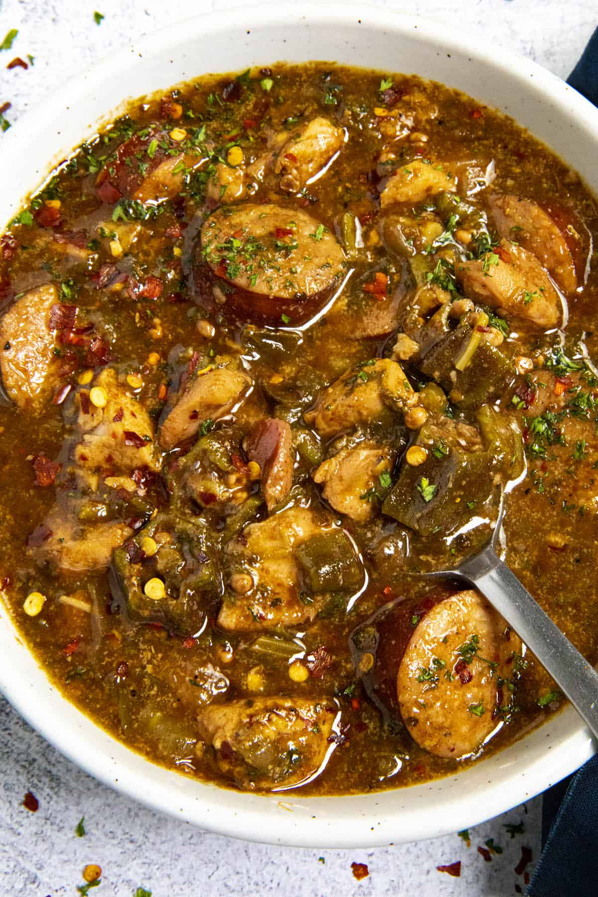 Cajun Chicken and Sausage Gumbo in a bowl with a spoon