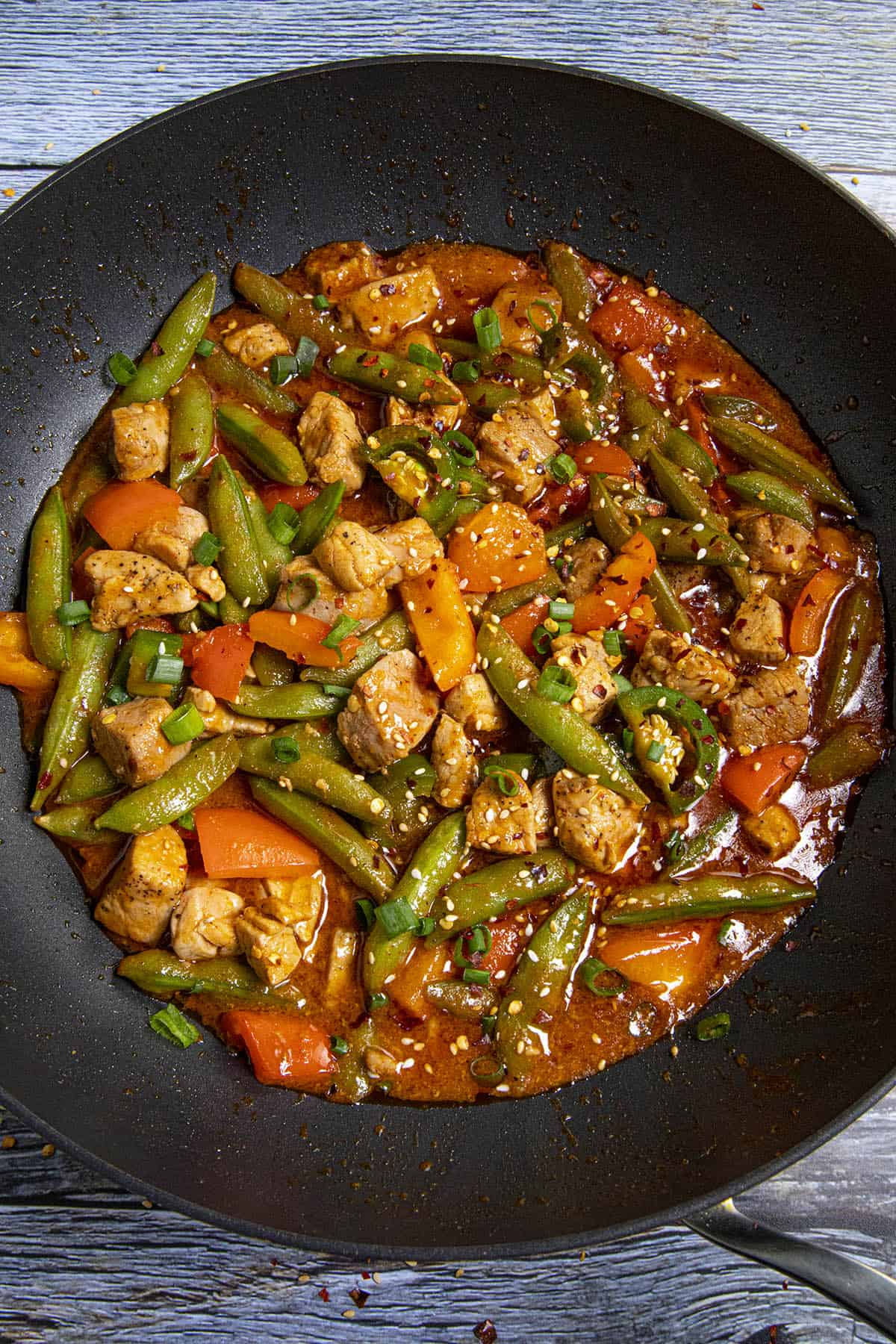 Spicy Pork Stir Fry in a pan with garnish